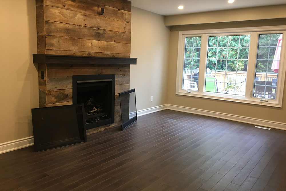 Barnboard Fireplace - horizontal boards - Whitby executive - family room - vacant